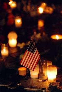flags and candles remembering WTC